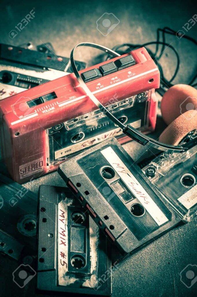 106610865 vintage cassette tape with headphones and walkman